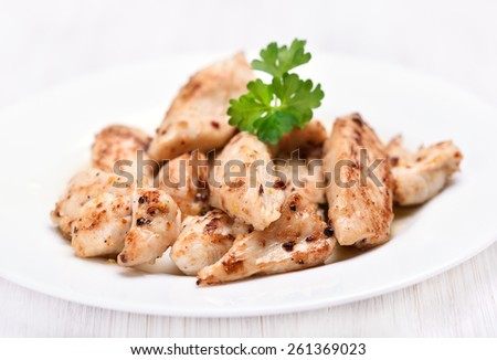 Chicken grill meat sliced on white plate, close up view - stock photo