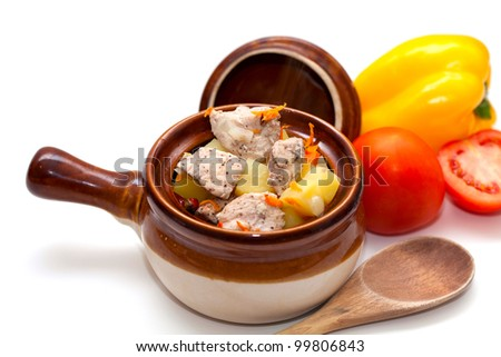 chicken in pot and vegetables isolated on white - stock photo