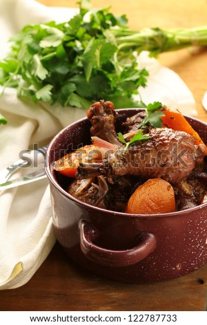 chicken in wine, coq au vin - traditional French cuisine - stock photo