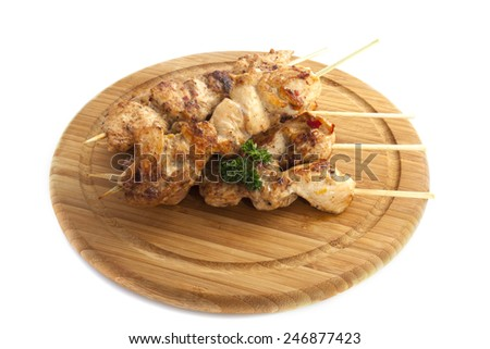 Chicken kebab on wooden sticks isolated over white - stock photo