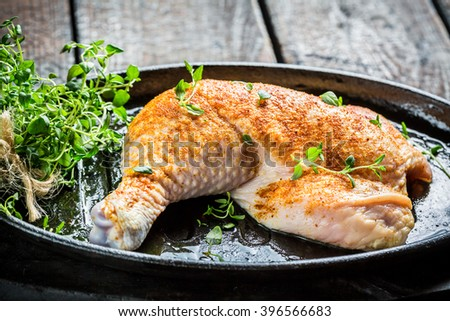 Chicken leg with herbs and spices ready for grilling - stock photo