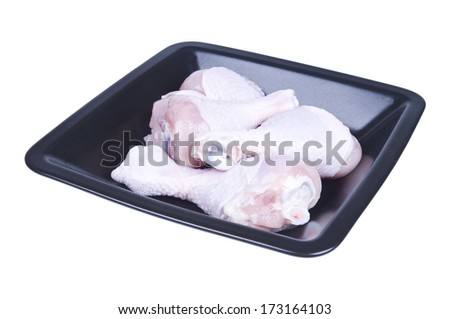 chicken legs on a plate isolated over white - stock photo