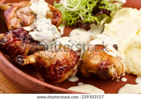 Chicken legs with mashed potatoes - stock photo