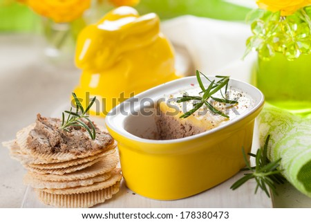 Chicken liver pate with crackers for Easter - stock photo