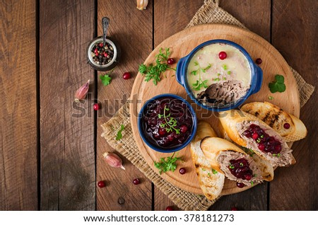 Chicken liver pate with cranberry sauce, served with croutons. Top view - stock photo