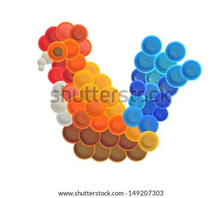 Chicken made of plastic bottle cap - stock photo