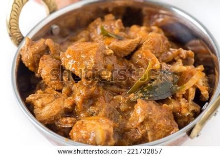 Chicken malabar curry in a traditional kadai or karahi bowl - stock photo
