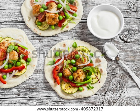 Chicken meatballs and fresh vegetables tacos. Healthy delicious breakfast or snack. On light wooden rustic background - stock photo
