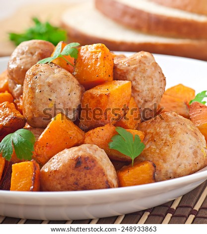 Chicken meatballs with a garnish cooked of baked pumpkin - stock photo