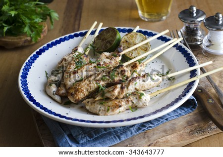 Chicken mini fillets with garlic, lime and chilli - stock photo