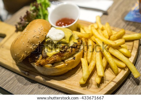 Chicken mushroom burger with fries - stock photo