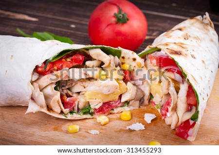 Chicken, Mushroom, Cheese and Spinach Burritos. Glass of Beer - stock photo