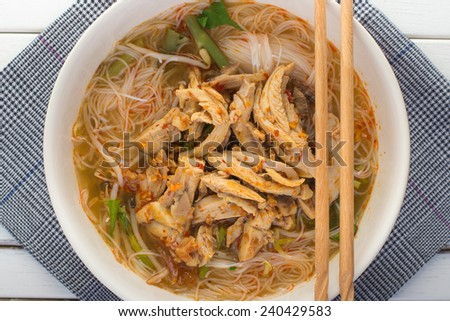Chicken noodle and on wood. thai food. - stock photo
