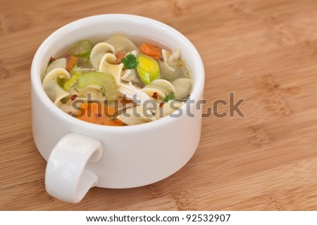 Chicken Noodle Soup closeup - stock photo