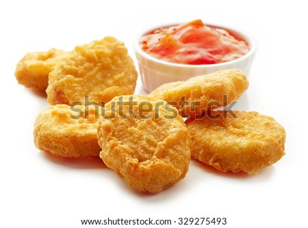 Chicken nuggets and sweet chili sauce isolated on white background - stock photo