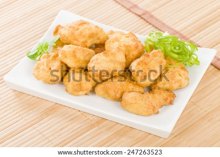 Chicken Nuggets - Battered and deep fried chicken pieces. - stock photo
