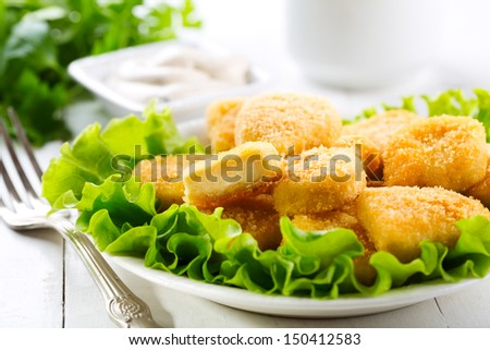 chicken nuggets on a plate - stock photo