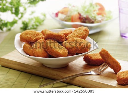 chicken nuggets served in a white bowl - stock photo