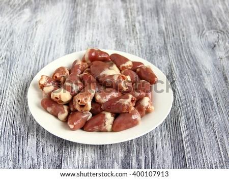 Chicken offal. Closeup of fresh raw chicken hearts. - stock photo
