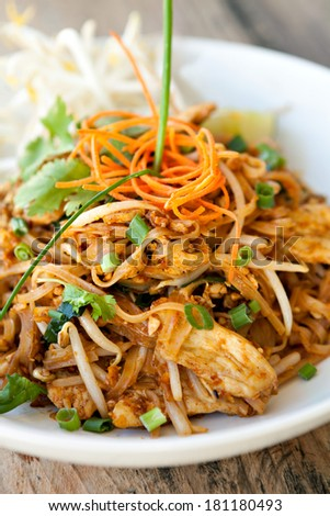 Chicken pad Thai dish of stir fried rice noodles with a contemporary presentation. - stock photo