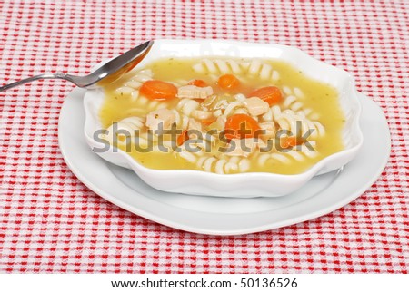 chicken pasta soup with spoon - stock photo