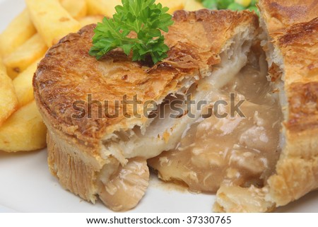 Chicken pie with chips - stock photo