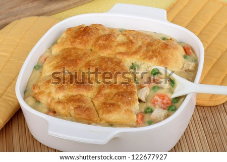 Chicken pot pie with carrots and peas - stock photo