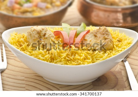 Chicken pulao with chicken curry - stock photo