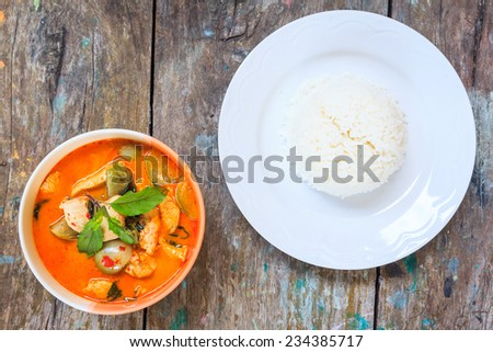 chicken red curry with rice, delicious thai cuisine - stock photo