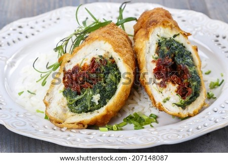 Chicken roll stuffed with spinach and dried tomatoes - stock photo