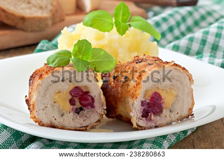 Chicken rolls with cranberries, cheese and honey with garnish of mashed potatoes - stock photo