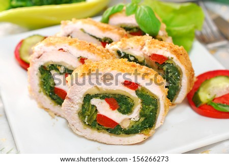 chicken roulade with spinach,cheese and red pepper for christmas dinner - stock photo