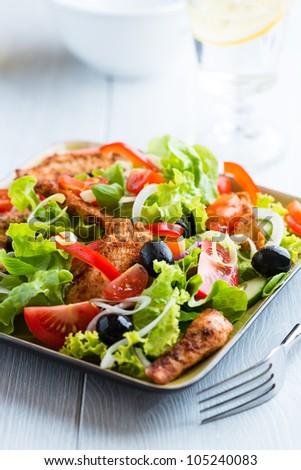 Chicken salad on kitchen table - stock photo