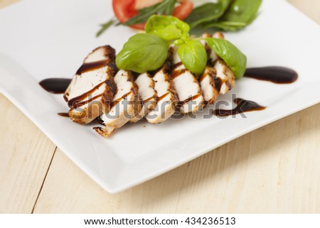 chicken salad with balsamico  - stock photo