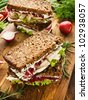 Chicken sandwiches with radicchio, lettuce, radish and cottage cheese. Shallow dof. - stock photo