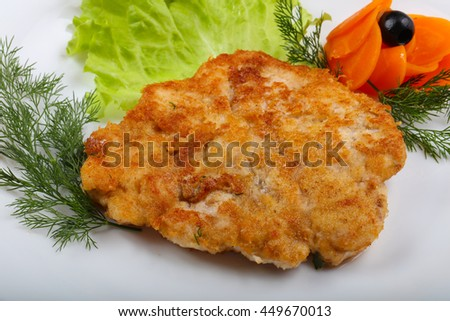 Chicken schnitzel served salad leaves and dill - stock photo