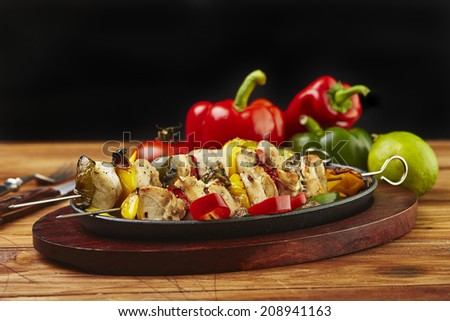 chicken Shish Kebab in a cast iron pot - stock photo
