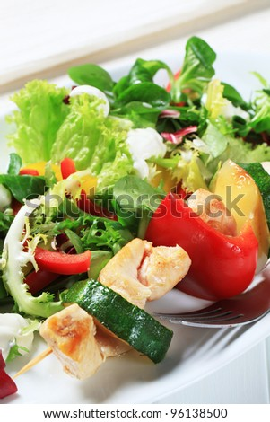 Chicken skewer with salad mix  - stock photo
