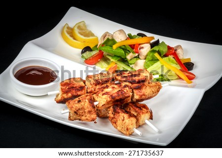Chicken skewers :An delicious chicken skewers with barbeque sauce and veggies salad Location: At Rawan Cake in Amman ,Jordan - stock photo