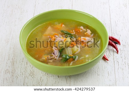 Chicken soup with dill and carrots - stock photo