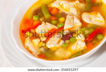 chicken soup with fresh vegetables - stock photo