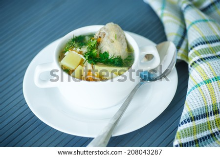 chicken soup with noodles in a bowl on the table - stock photo