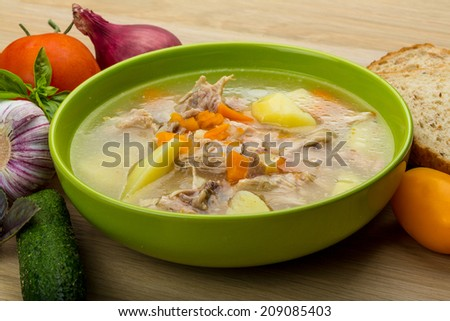 Chicken soup with vegetables and basil - stock photo