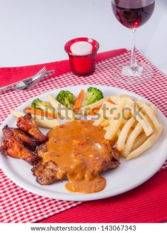 chicken steak with chicken wing - stock photo