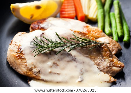 chicken steak with rosemary and sauce  - stock photo