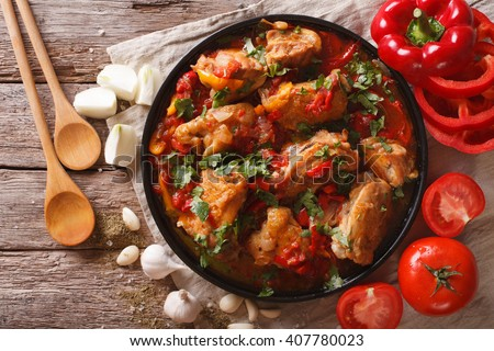 chicken stew with vegetables on a table close-up. horizontal view from above