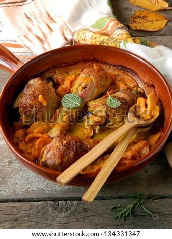 Chicken stewed with pumpkin - stock photo