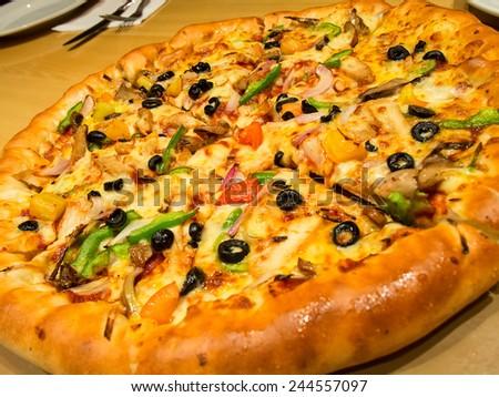 Chicken supreme pizza - stock photo