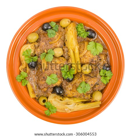 Chicken Tagine - Moroccan chicken tagine with olives, preserved lemon and fennel. Overhead shot isolated on a white background. - stock photo