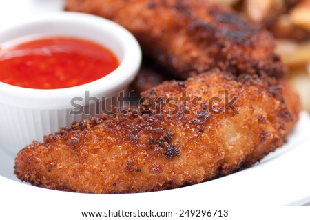 chicken tenders with fries and dipping sauce - stock photo